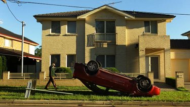 Party night: This car was overturned in Wentworthville.