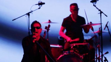U2 members Bono, left, and Larry Mullen Jr perform during an announcement of new products by Apple on Tuesday in Cupertino, California.