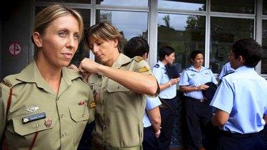 ''We wear it with pride'' … Corporal Renae Fritzell-Flint adjusts the uniform of her partner, Corporal Danielle Gurkin.