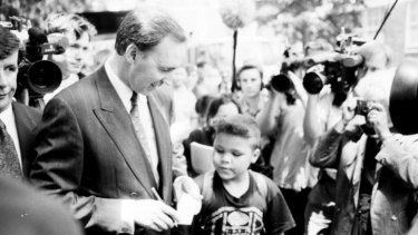 Former Australian Prime Minister, Paul Keating, signs an autograph after delivering an emotional speech in Redfern, Sydney, to mark the International Year of the World's Indigenous People in 1992.