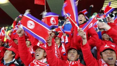 Supporting their team ... the North Korea fans picked to travel to South Africa cheer on their side.