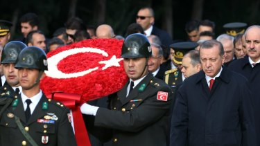 Turkish President Recep Tayyip Erdogan, right, follows a military honour guard to the mausoleum of the republic's founder Mustafa Kemal on October 29,  Republic Day.
