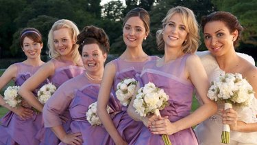 Vow row ... (from left) Ellie Kemper, Wendi McLendon-Covey, Melissa McCarthy, Rose Byrne, Kristen Wiig and Maya Rudolph join the wedding party.