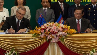 Australia's then immigration minister Scott Morrison and Cambodian Interior Minister Sar Kheng sign an agreement to resettle refugees in Cambodia.