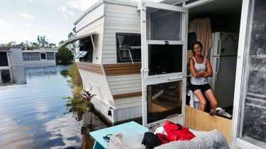 Cherie Ethier sits in her mobile home with her pets surrounded by floodwater in Naples, Florida.