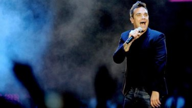Having a ball: Robbie Williams is back being a pop star.