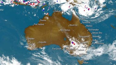 A satellite image showing Cyclone Ita bearing down on north Queensland.