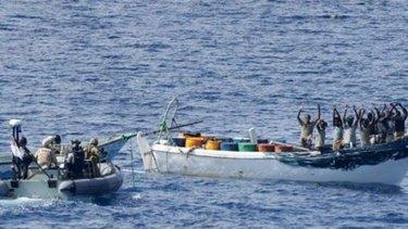 HMAS Melbourne's crew approaches the suspected pirates.