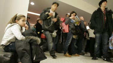 Flights grounded ... passengers wait to be rescreened at an airport in Newark, New Jersey, after a security scare.