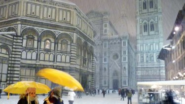 A rare sight ... heavy snowfalls blanket Florence in Italy.