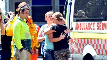 People react on the scene as Bridget is taken away by ambulance.