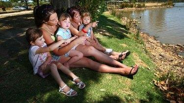 Samara Stewart with her niece Tahnee and daughter Keira, with Samara's Aunt Sue Kay and her grandaughter Charlotte lakeside at Sumison Gardens, Wodonga.