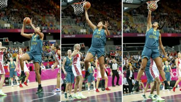 One, two, three ... Liz Cambage unleashes a slam dunk against Russia.