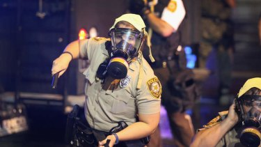 Police put on riot gear to confront demonstrators.