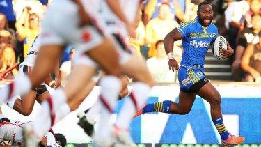 Hat-trick: Semi Radradra of the Eels on the way to one of his three tries against the Warriors.
