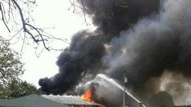 Smoke billows near an apartment complex where a Navy jet crashed.