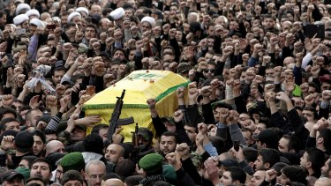 Hezbollah fighters in Beirut carry the coffin of Jihad Mughniyeh, the son of Imad Mughniyeh, a top Hezbollah operative assassinated in 2008 in Damascus and one of the six Hezbollah fighters killed in an Israeli airstrike.