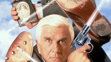 Neilsen as hapless detective Frank Drebin in The Naked Gun series.