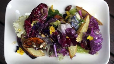 Seasonal roasted vegetables, mixed lettuce, goats curd, almonds, herbs, bread crumbs and olive oil.