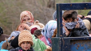 Syrian refugees arrive near the border between Syria and Turkey on Thursday.