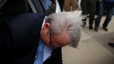 Prime Minister Kevin Rudd was buffeted by wind gusts at Macquarie University in the seat of Bennelong in Sydney.