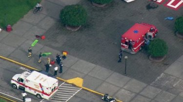 This image made from a video provided by KOMO shows emergency personnel responding after reports of a shooting at Marysville-Pilchuck High School in Marysville, Washington.