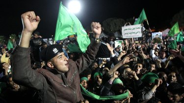 Supporters of the Gaddafi regime at a staged Tripoli demonstration, in pictures taken on a trip organised by the Libyan authorities.