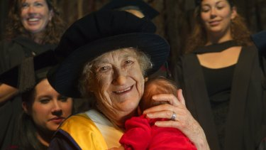 Rhodanthe Lipsett, 90, grained an honorary doctorate for services to midwifery and used her skills to calm fellow graduate Tess Farrell's six-week-old daughter Jade at the graduate class.