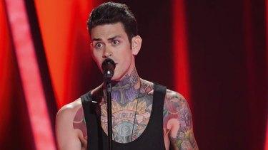 Heavily tattooed Launceston 24-year-old Matthew Garwood completes Ricky's team.