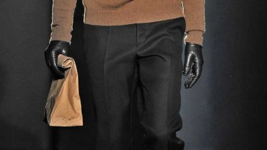 Jil Sander sent models down the a/w 2012 catwalk holding the designer loot.