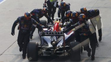 Push start: Daniel Ricciardo is pushed back to the pits after a wheel malfunction and retired shortly after.