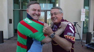 Wayne Swan and Anthony Albanese pictured in a friendly tussle ahead of a state of origin game earlier this year.