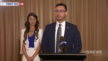Salim Mehajer at a lectern, with his wife Aysha beside him, during his interview with Nine News.