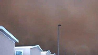 The tornado, filmed by oil worker Dan Yorgason, turns the sky dark.