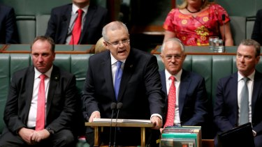 Treasurer Scott Morrison delivers the Budget speech in the House of Representatives at Parliament House in Canberra.