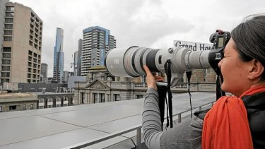 The Age photographer Penny Stephens stands on a balcony at Media House and photographs Eureka Tower.  The building is approximately the same distance as the photographer who captured photographs of a topless Kate Middleton.