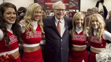 The Sage of Omaha: Berkshire Hathaway chairman and chief executive Warren Buffett poses with University of Nebraska cheerleaders.
