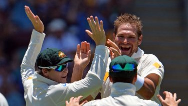Teammates celebrate with Australia's pacemen Ryan Harris after claiming the wicket of England captain Alastair Cook.