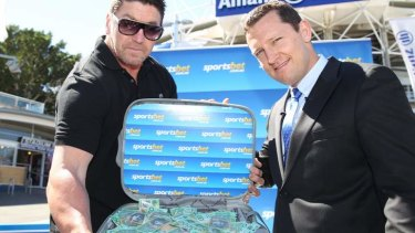 Cashed up: Mark ''Spud'' Carroll holds the $100,000 Joel Caine revealed Sportsbet would pay to a charity if the premier comes from outside the NRL top four.