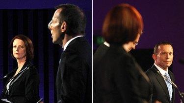 Moments from a debate: Julia Gillard and Tony Abbott last night.