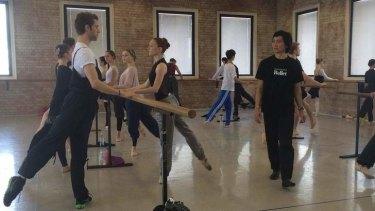 Queensland Ballet artistic director Li Cunxin walks American dancers James Whiteside and Gillian Murphy through a class in Brisbane.