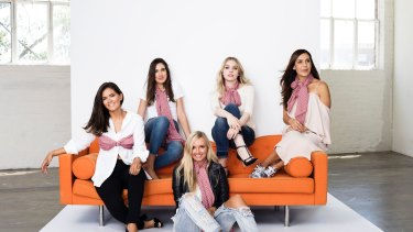 Canberra Fashion blogger Janette Lenk (seated far left) was selected to be one the faces to launch a UN Women National Committee (NC) Australia purple scarf to mark International Women's Day.