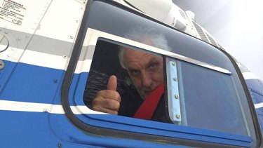 Thumbs up: Phillip Noyce aboard a helicopter filming <em>The Giver</em> in Utah, which stars Meryl Streep, Jeff Bridges, Katie Holmes, Taylor Swift, Brenton Thwaites and Alexander Skarsgard.