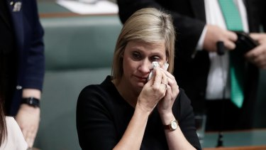 Labor MP Susan Lamb wipes away tears after delivering a statement on her citizenship after Question Time.n