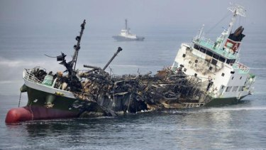 The Shoko Maru lists before sinking after a massive explosion rocked the Japanese tanker.