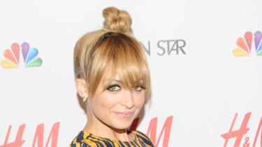 Nicole Richie, who stands at 152cm, says she has trouble finding clothes that fit - and instead has a penchant for heels and bags (and high hairdos).