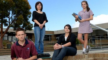 Kurnai College students Jack Findlay (left), teacher Kathy Tan, Caitlin Slater and Jessica Fossati are feeling the effects of budget cuts.