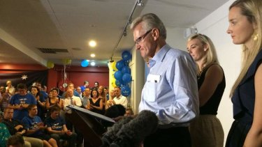 Bill Glasson addresses supporters at the Morningside AFL club.