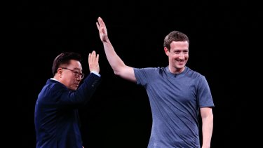 Facebook's Mark Zuckerberg makes a surprise appearance onstage, taking over from  Samsung's president of mobile communications Koh Dong Jin.