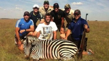 Courting controversy: Crusaders players George Whitelock, Tyler Bleyendaal, Sam Whitelock, Tom Taylor and Ben Funnell with guides on a hunt in South Africa.